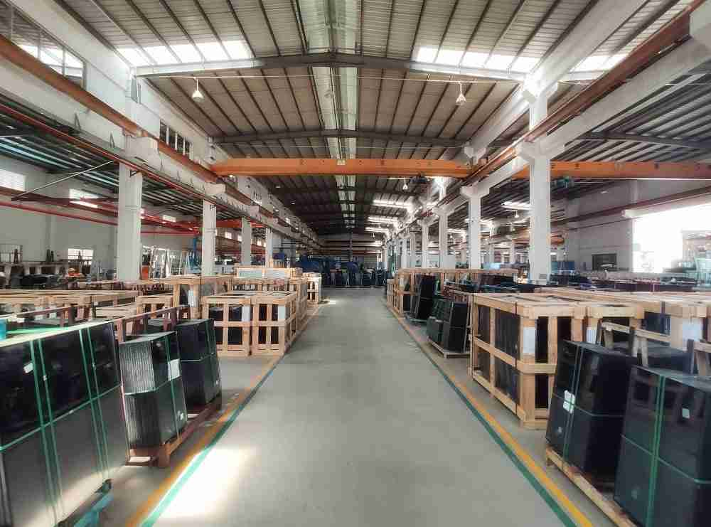 Shenzhen Dragon Glass plants with many storage of glass products.